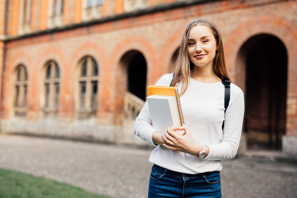 Photo of a Student holding a notebook