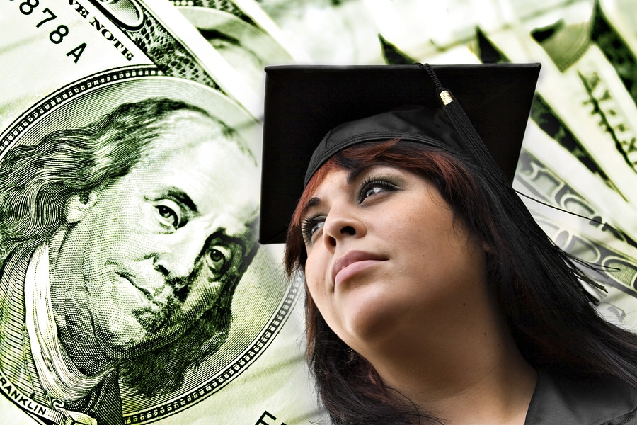 Picture of graduate next to 100 dollar bill