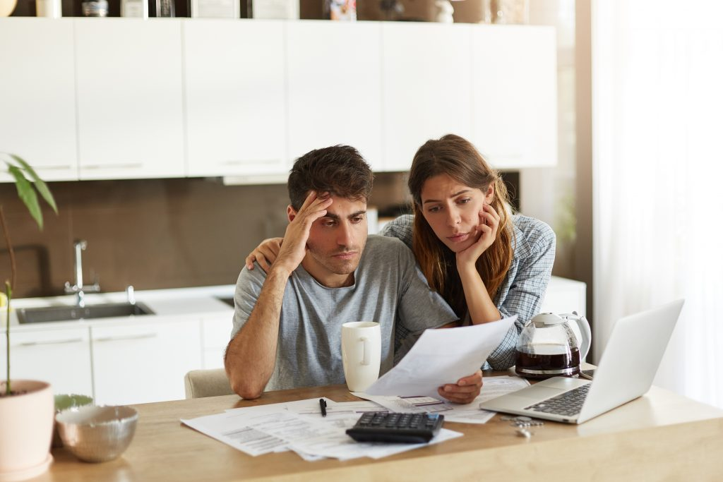 Picture of a couple reviewing paperwork